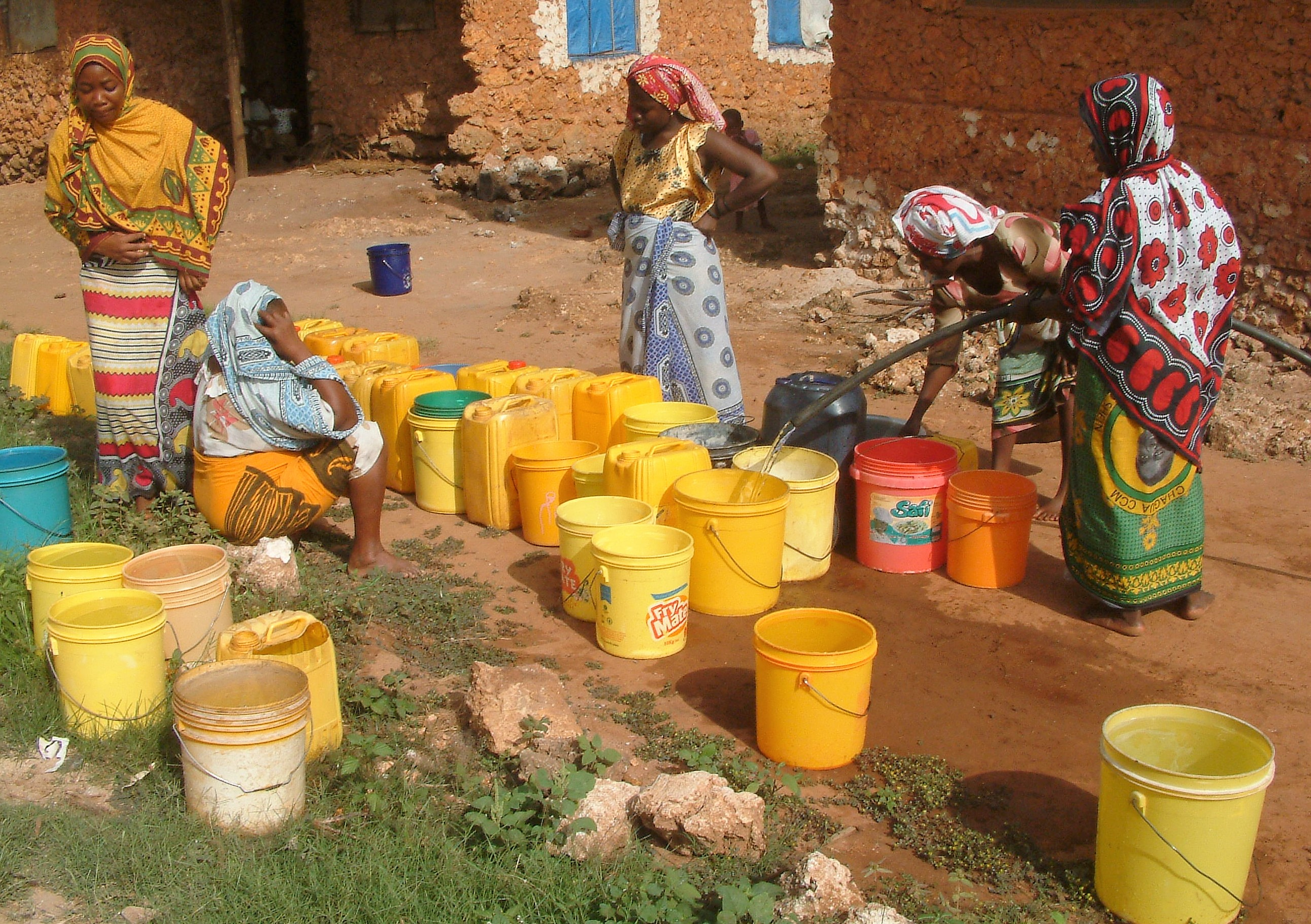 Women filling buckets